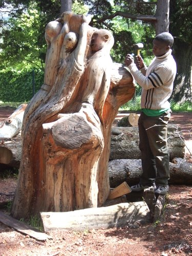 Right Mukore busy with a sculpture at Montebello Design Centre